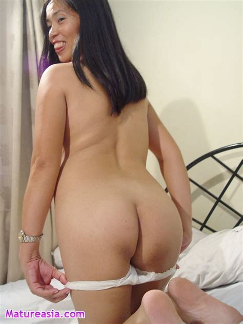Big Tits On A Cute Asian Milf In Stockings