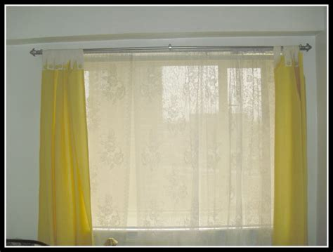 roller shades combined with curtains at manila philippines