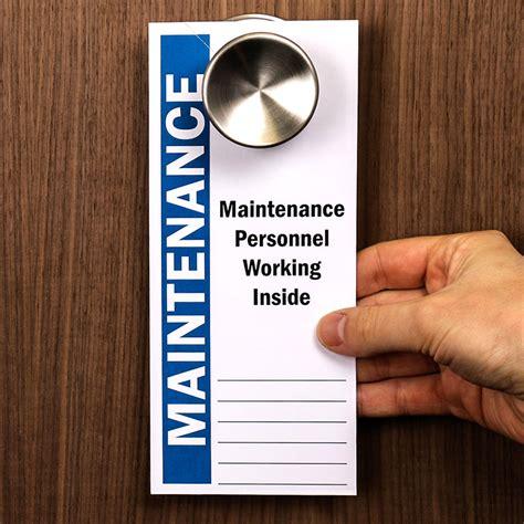 Maintenance Personnel Working Inside Door Knob Hanger Tag