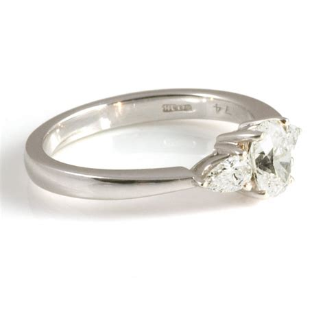 platinum oval and pear diamond ring