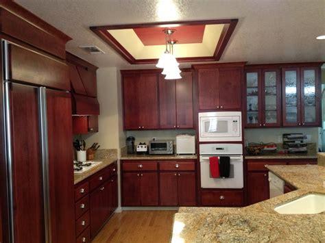 trim around kitchen cabinets cherry wood kitchen cabinets resurfacing project