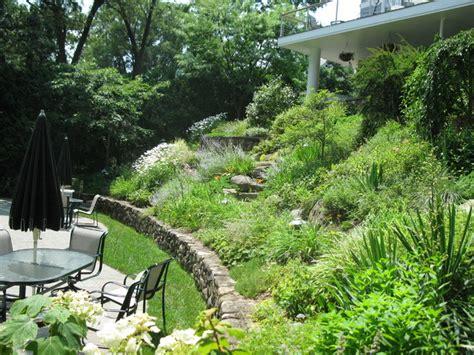 garden landscaping ideas  downward sloping backyard