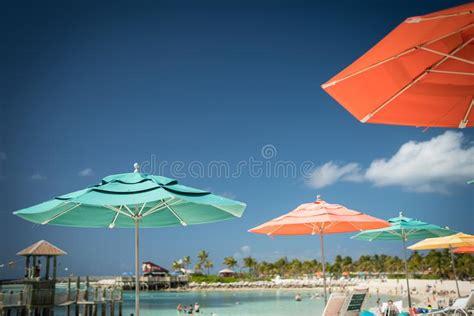 People Relaxing Under Beach Umbrellas Editorial Stock