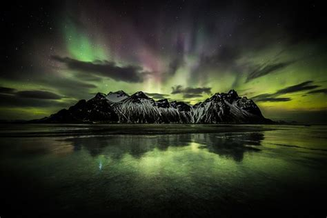 iceland in february northern lights the aurora borealis northern lights over stokknes