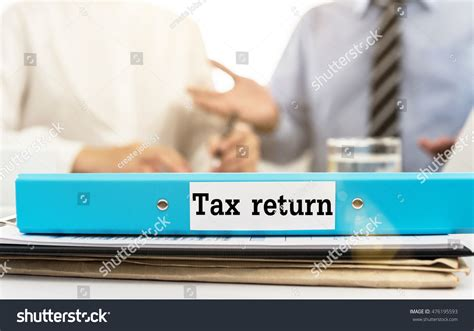 Opm Desk Audit Back Pay by Tax Return Document Folder On Desk Stock Photo 476195593