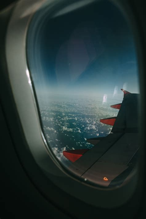 airplane window overlooking clouds  stock photo