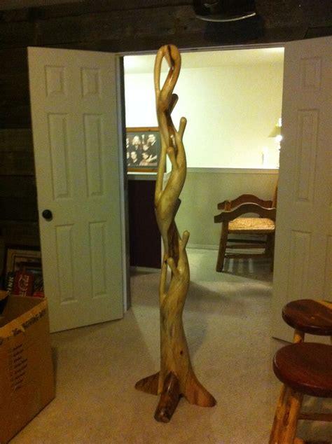 hat  coat rack    tree root  rustic