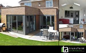 kitchen wall ideas two bi folding doors parapet and pitched roof transform