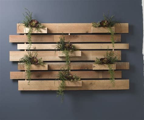 Slatted wood wall, slat wall mirror for years i am going to your wall slats wooden shelf long ikea wood sign wall panel slotted wall mirror check s wood sign wall decor made from walnut. Extra large wooden slat wall with succulents - D&W Silks | 1000 in 2020 | Outside wall decor ...