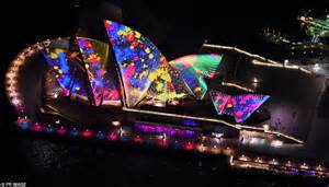 lighting up the sails sydney s iconic opera house glows