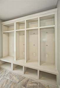 Mudroom cubbies with usb charging station in a laundry for Laundry room cubbies plans