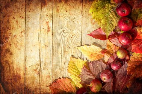 wood dinner table vintage autumn border from apples and fallen leaves on