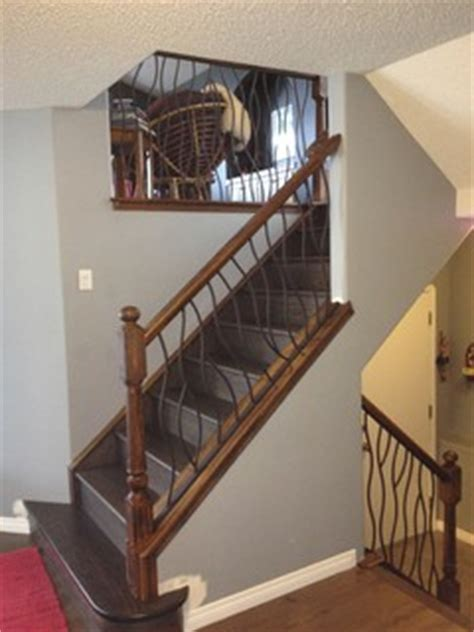 bent iron design interior railing   distressed wood