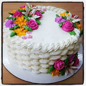 Buttercream basket weave cake with royal icing flowers ...
