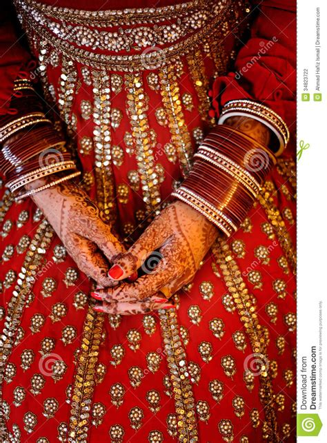 indian brides hands wearing bangles decorated