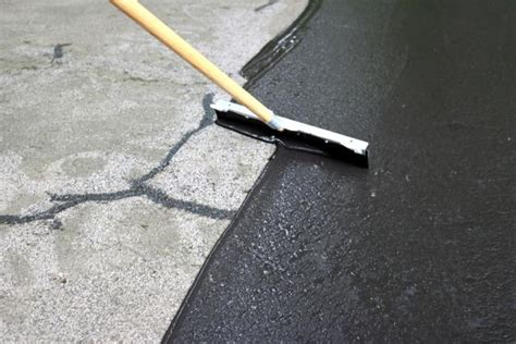 how to fix cracks in a driveway and apply a coat of