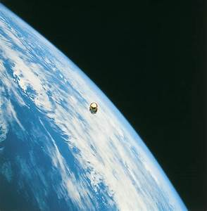 Satellite In Orbit Around The Earth Photograph by Stockbyte