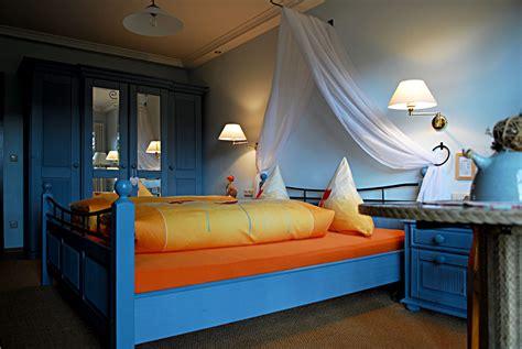Gorgeous Blue Bedroom Interior Set With Orange Bedding