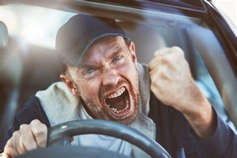 enraged man shaking fist  windscreen road rage
