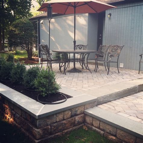 two tier patio using wallstone and bluestone coping