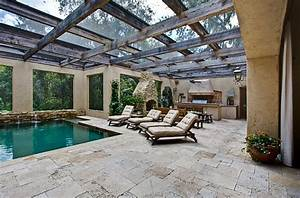 Lovely pool area combines Mediterranean style with a touch