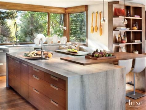important features in kitchen island the kitchen features cabinets fabricated by woden woods and a center island draped with honed