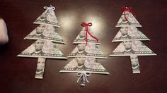 fold dollar into christmas tree 1000 images about folding dollars into shapes on money origami dollar bill origami