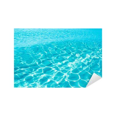 foto de Vinilo Pixerstick Ondulación azul turquesa Formentera agua