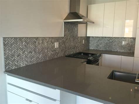 marble mosaic herringbone pattern  schluter trim