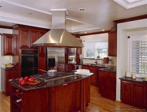 wood flooring with cherry cabinets black appliances wood floor green kitchen traditional dark wood cherry kitchen cabinets 26