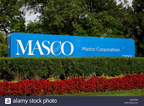 A logo sign outside of the headquarters of the Masco ...