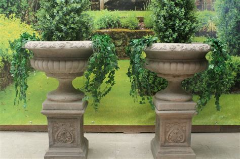 Two Stone Garden Statues Urns & Plinths