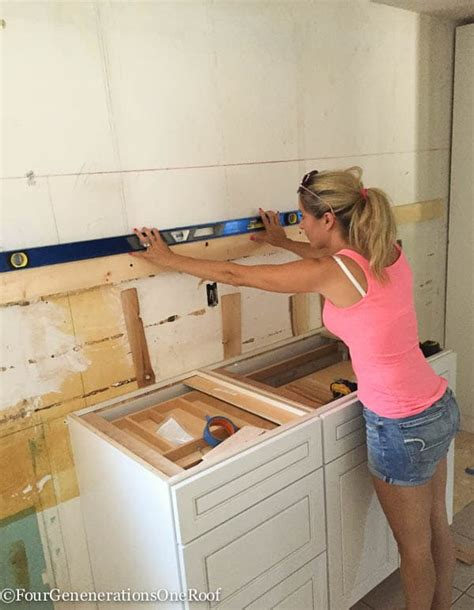 how to install upper cabinets our kitchen renovation series installing new cabinets