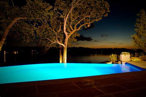 lake house infinity edge pool  integrated spa modern