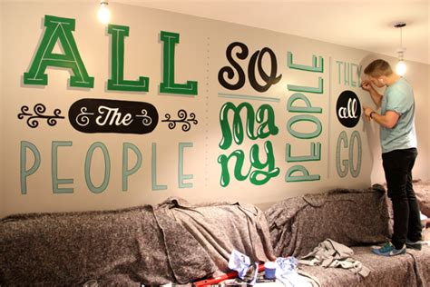 typography mural for holiday inn graphic art news