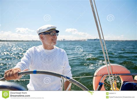 What Is The Helm Of A Boat by Senior At Helm On Boat Or Yacht Sailing In Sea Stock