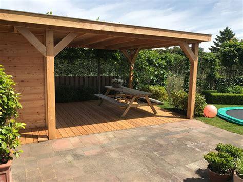 tuin met vijver vlonder en overkapping veranda martien van zaal
