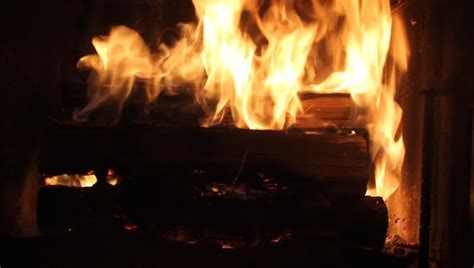 medium of a yule log burning in a fireplace stock