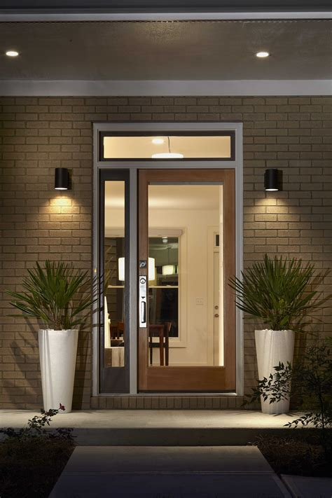 front entrance outdoor lighting modern prairie style home in east atlanta features a glass