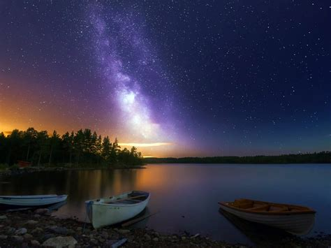 peaceful lake boats wooden house forest sky  stars