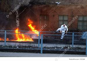 Man Running Away From Fire Stock Photo I1351266 At Featurepics