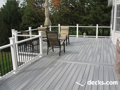 gray composite decking with a decorators aluminum baluster