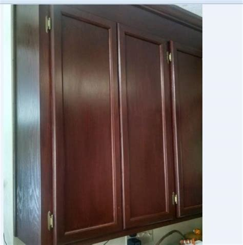 best way to stain kitchen cabinets best way to apply stain to cabinets doityourself 9248