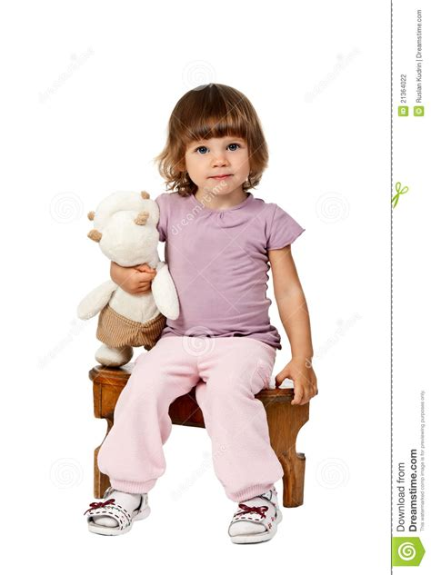 2 Legged Chair by Little Sitting On A Wooden Stool Stock Photography