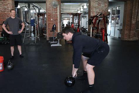 kettlebell swing exercise rehak james corrective trainer movement patterns demonstrating