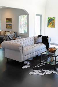 Cowhide rug and linen chesterfield sofa eclectic for Cowhide rug in living room