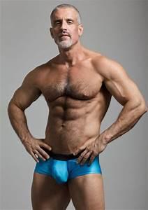 Muscular hung gay men