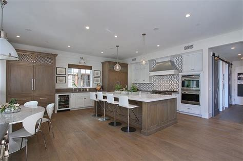 White Kitchen With Distressed Brown Island Contemporary