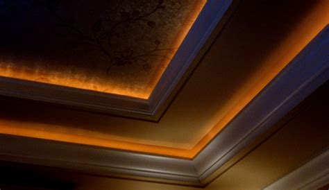 wallpapered ceiling with lighted crown molding