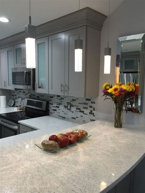 Cambria   Whitney counters Kraftmaid   Pebble Grey cabinet